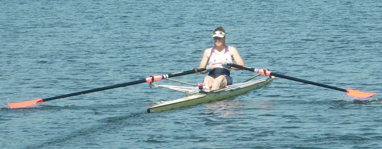 Woman rows away on a sunny day at the Lake Sammamish race
