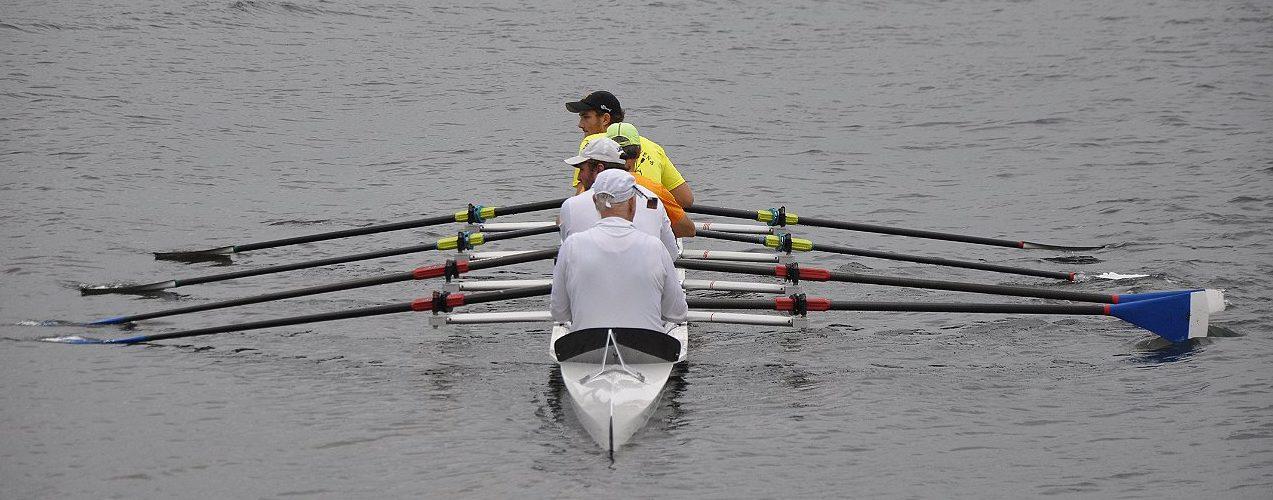 The accomplished Storb quad rows toward us, paddles aligned