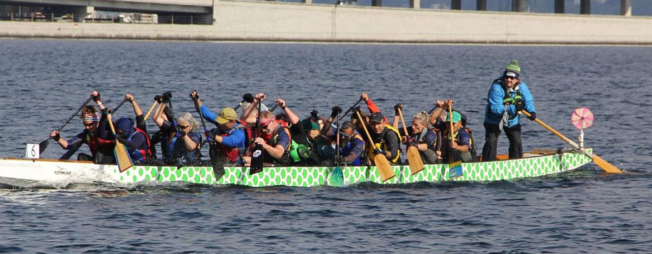 Dragon Boat crew racing past the bridge