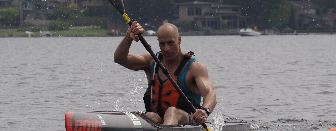Single surf skier paddles intensely